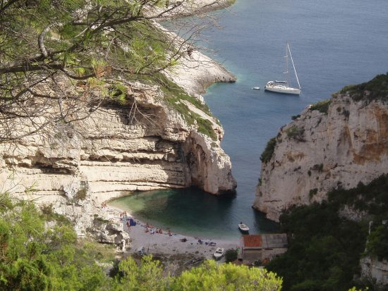 Swim in the sheltered waters of Stiniva Beach in Vis